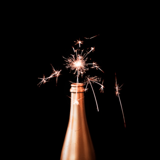 Burning bengal light in champagne bottle Free Photo