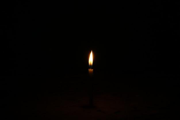 Burning Candle On A Dark Background Free Photo