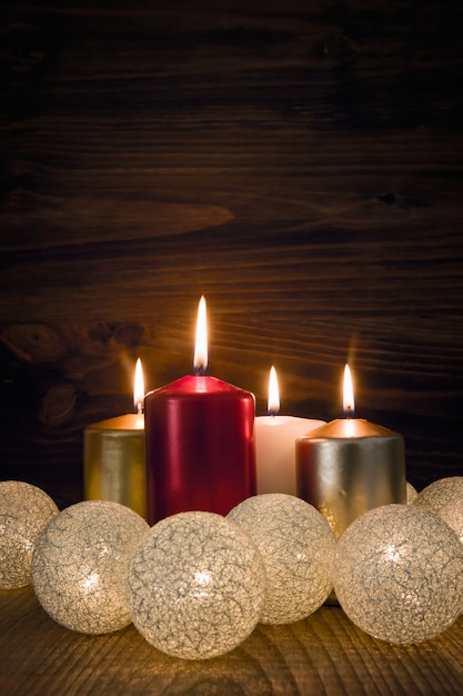 Burning candles with white balls Free Photo