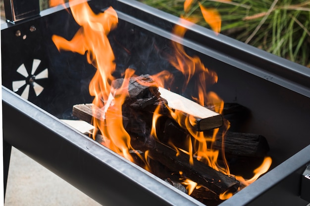 Burning charcoal in barbecue grill Free Photo