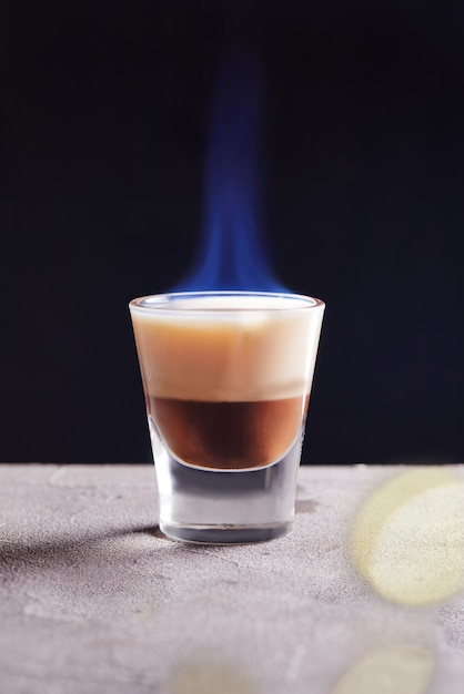 Burning chocolate vanilla cocktail in a glass Premium Photo