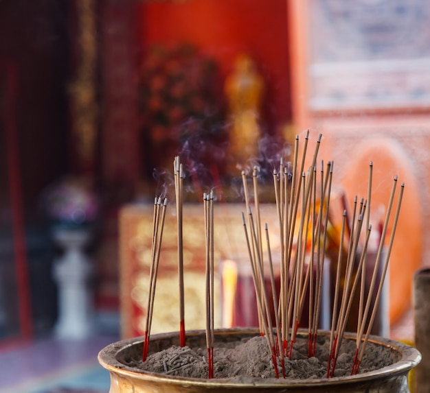 Burning incense in chinese buddhist temple background Premium Photo
