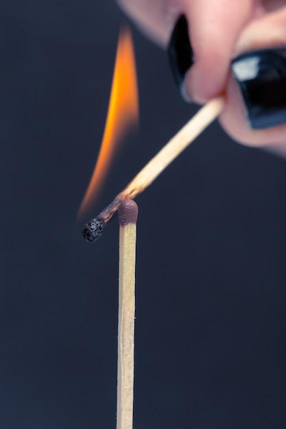 Burning match Premium Photo