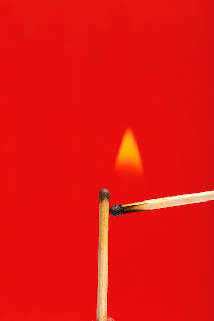 Burning match Premium Photo
