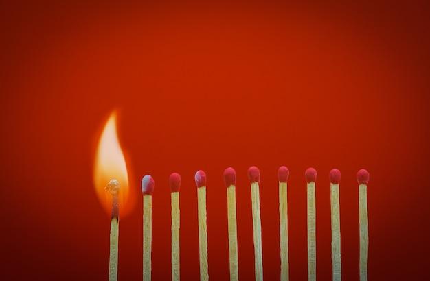 Burning matchsticks setting fire to its neighbors Premium Photo