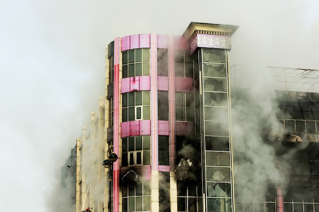 Burning shopping center or mall with smoke Free Photo