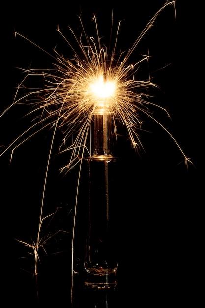 Burning sparkler in bottle Free Photo