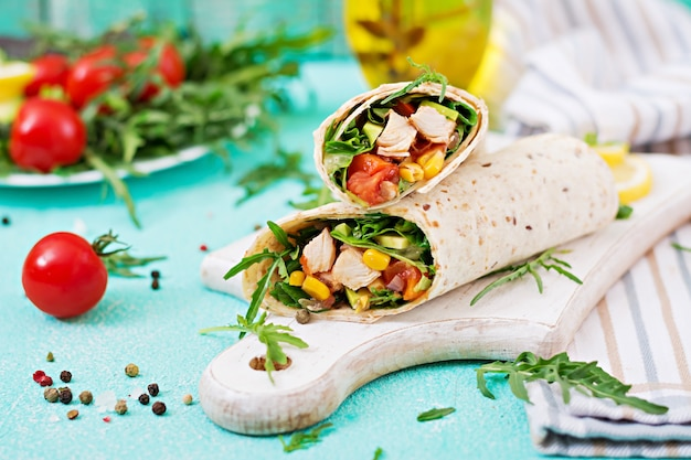 Burritos wraps with chicken and vegetables. chicken burrito, mexican food. Free Photo