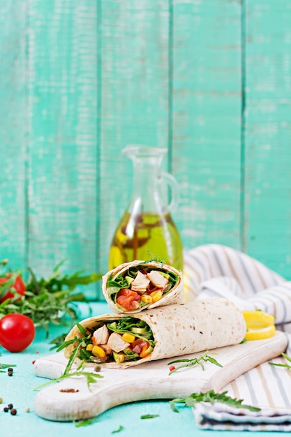 Burritos wraps with chicken and vegetables on light  background. Premium Photo