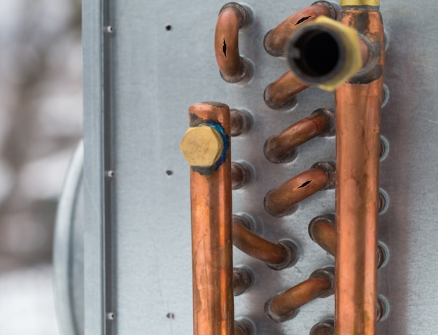 Burst copper pipes from the cold, closeup Free Photo