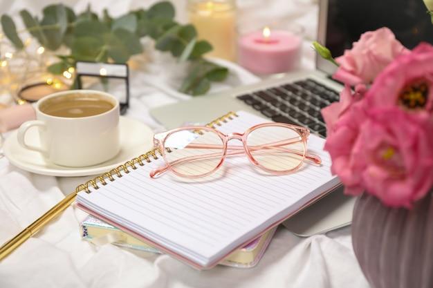 Business accessories on white cloth background. blogger concept Premium Photo