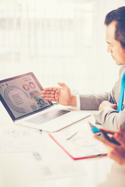 Business adviser analyzing financial figures denoting the progress Premium Photo