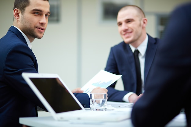 Business adviser analyzing a report Free Photo
