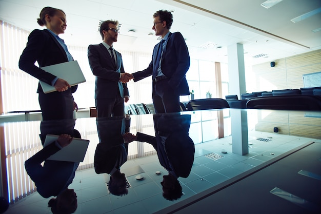 Business agreement and handshake Free Photo