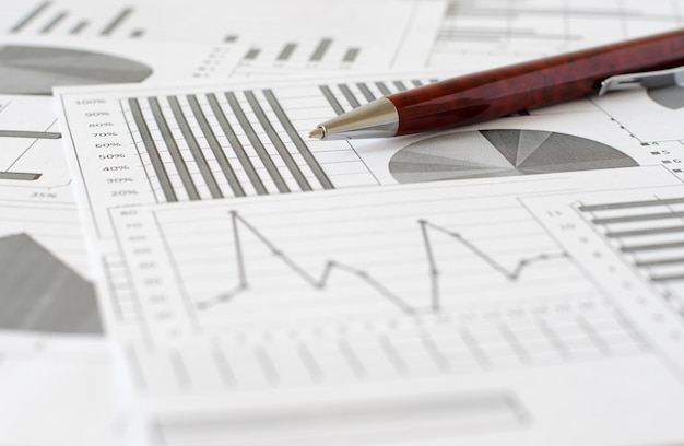 Business analytics, graphs and charts. a schematic drawing on pa Premium Photo