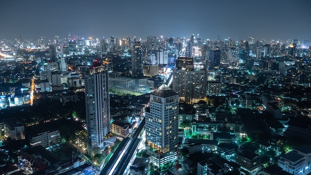 Business area in bangkok, thailand, showing buildings and traffic at night Premium Photo