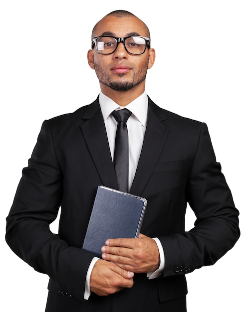 Business black man holding a book Premium Photo