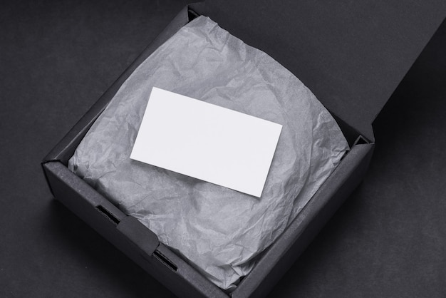 Business card inside of black gift box, mocup Premium Photo