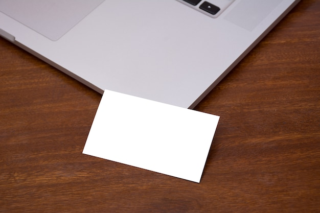 Business card mockup macbook photo premium download business card mockup macbook premium photo reheart Image collections