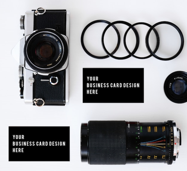 Business card mockup with old film camera and lenses with filters and glasses Premium Photo
