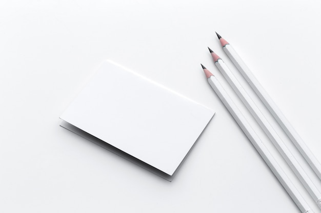 Business card with pencil Premium Photo