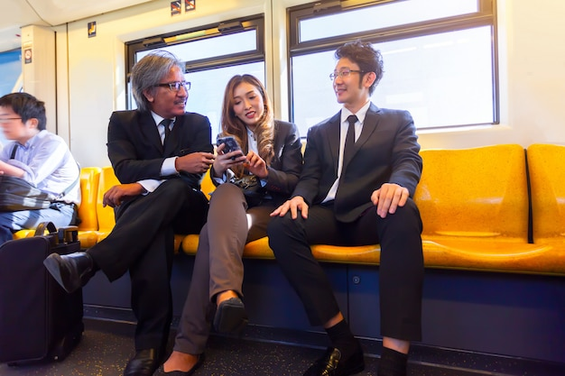 Business company meeting on skytrain transit system public impassioned while going work in Premium Photo