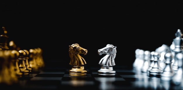 Business competition and strategy plan concept. chess board game gold and silver colour. panoramic image Premium Photo