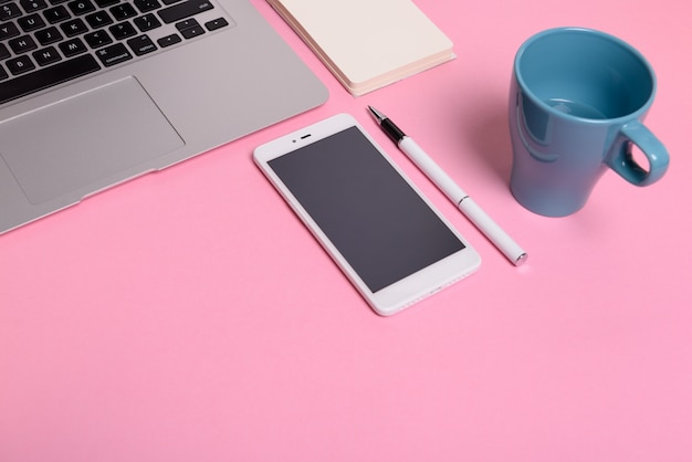 Business Concept Office Desktop With Laptop Mobile Phone Pink