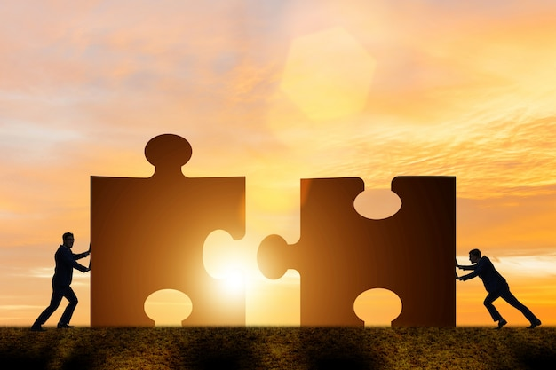 Business concept of teamwork with jigsaw puzzle Premium Photo