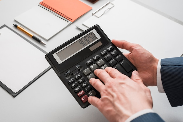Business concept with hands using calculator Free Photo