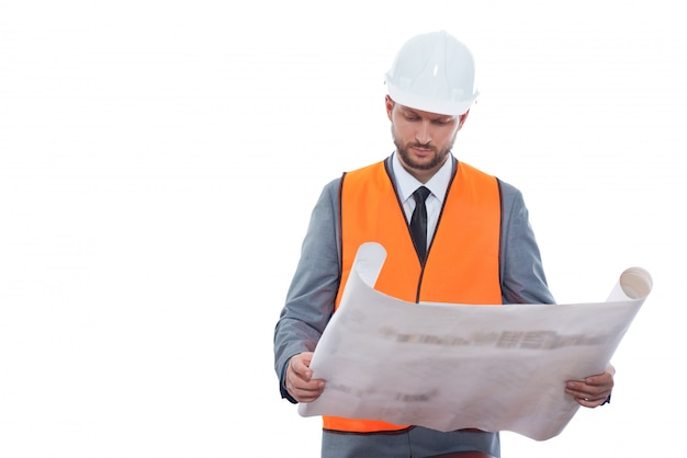 Business under construction. professional male constructionist in a safety vest and helmet working on a building project Free Photo
