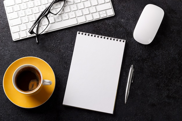Business desk table wtih keyboard coffee notepad glasses pen