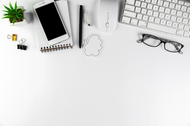 Business desktop with office elements Free Photo