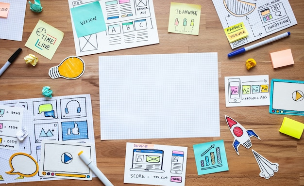Business digital marketing with paperwork sketch on wood table analysis strategy Premium Photo