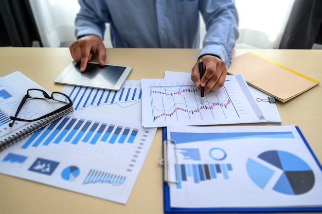 Business documents on office  graph financial Premium Photo