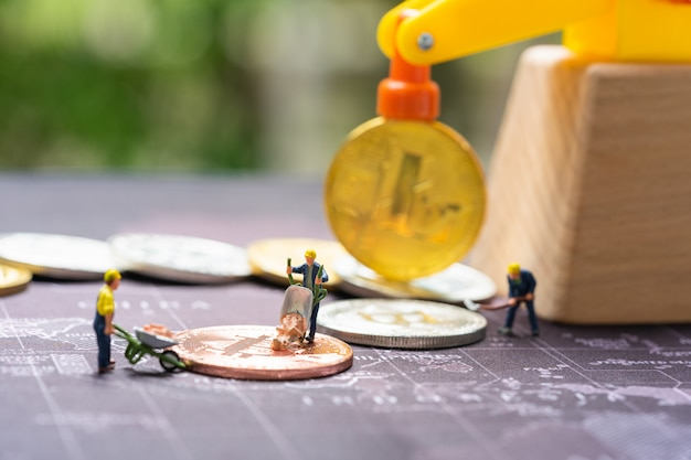 Business and finance, miners working in bitcoin mine. Premium Photo