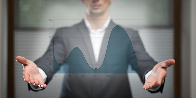 Business graph in hologram watched by man Premium Photo