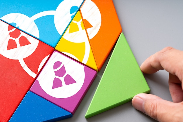 Business and hr human resource management icon on colorful puzzle Premium Photo
