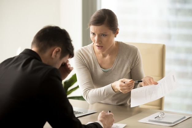 Business lady insists on changing of contact text Free Photo
