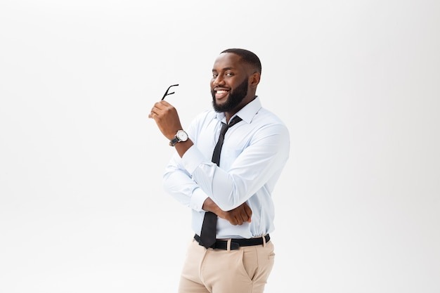 Business man african american with glasses thinks on isolated white background Premium Photo