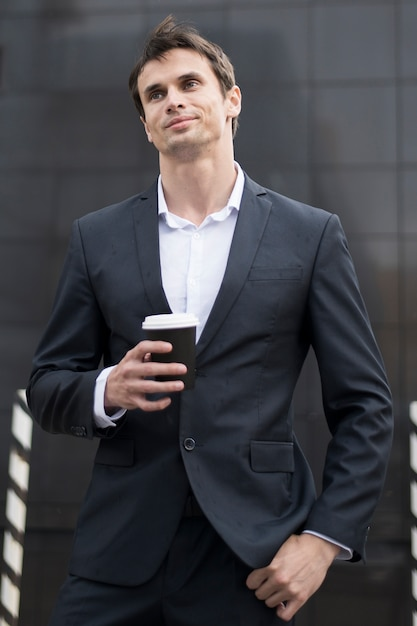Business man on break with cup of coffee Free Photo