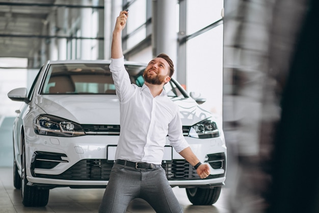 Business man buying a car in a showroom Free Photo