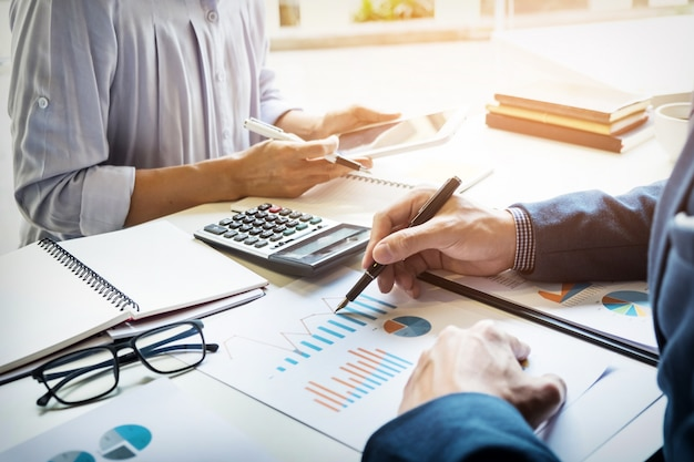 Business man financial inspector and secretary making report, calculating or checking balance. internal revenue service inspector checking document. audit concept Free Photo