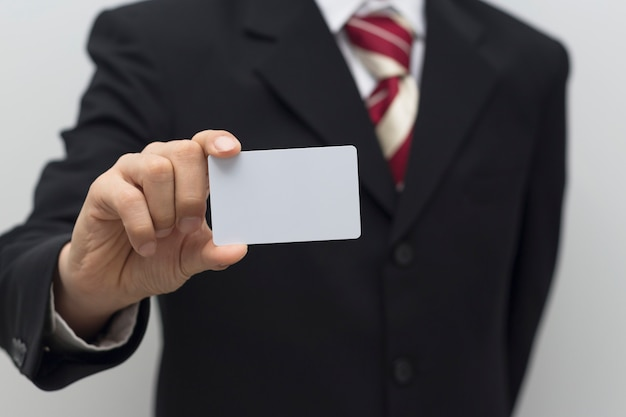 Business man hand holding white card Premium Photo