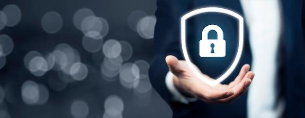Business man hand lock in screen inbokeh background Premium Photo