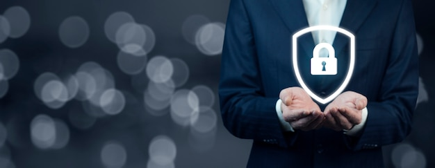 Business man hand lock in screen inbokeh background Premium Photo