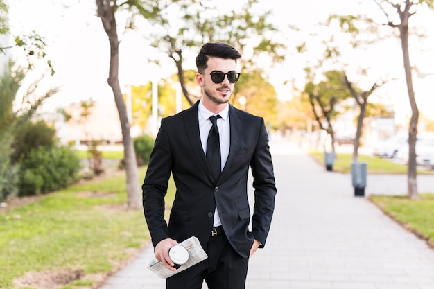 Business man having a walk at the park Free Photo
