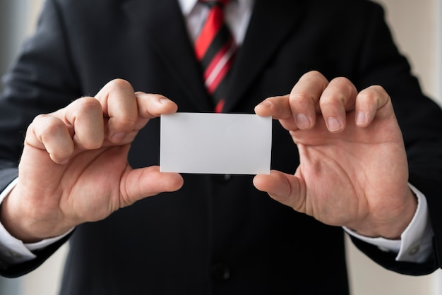 Business man holding blank business card Free Photo