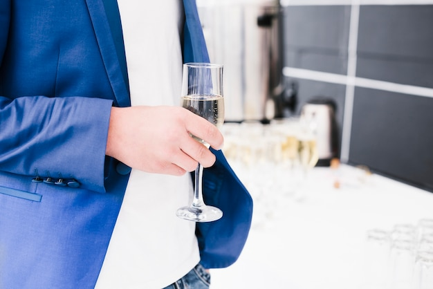 Business man holding cup of champagne Free Photo