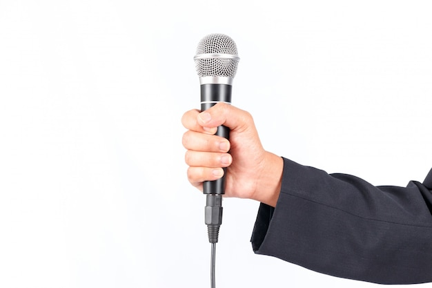 Business man holding a microphone isolated on white background Premium Photo